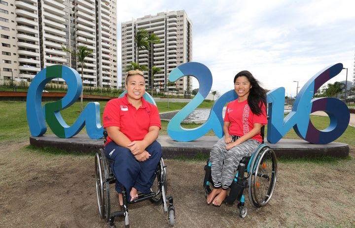 Theresa Goh and Yip Pin Xiu pose for a picture during a tour of the Paralympic village.