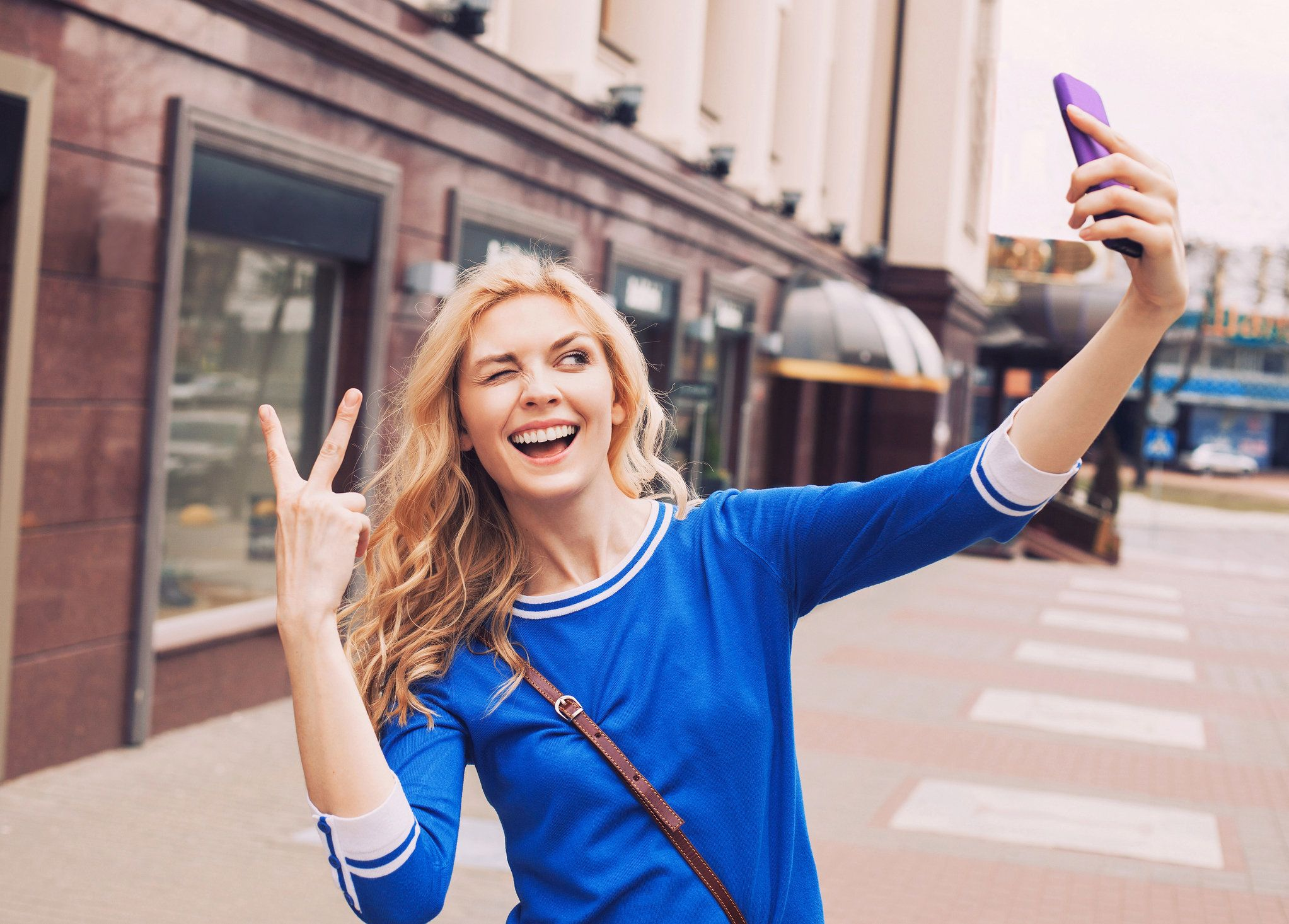 Young woman taking a selfie in a city