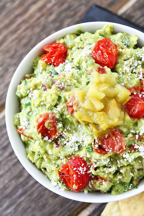 "<strong>Get the <a href=""http://www.twopeasandtheirpod.com/green-chile-and-roasted-tomato-guacamole/"" target=""_blank"">Green C"