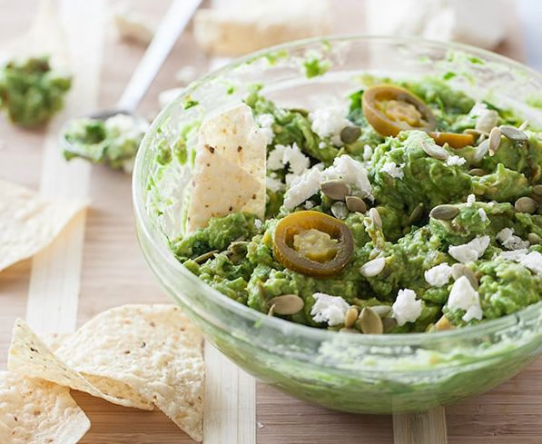 "<strong>Get the <a href=""http://www.foodiecrush.com/2013/05/roasted-garlic-and-pickled-jalapeno-guacamole/"" target=""_blank"">R"