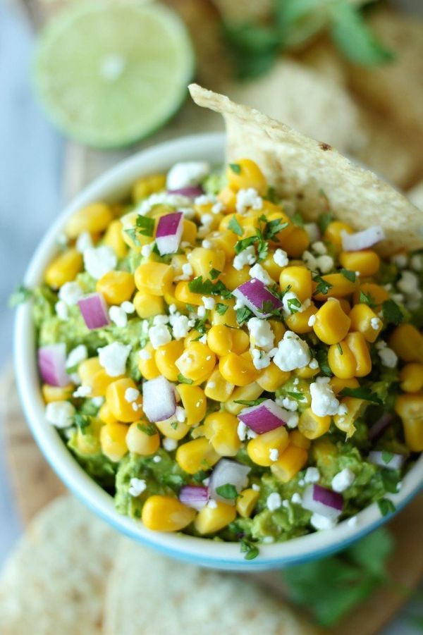 "<strong>Get the <a href=""http://damndelicious.net/2013/08/18/sweet-corn-grilled-guacamole/"" target=""_blank"">Sweet Corn Grille"