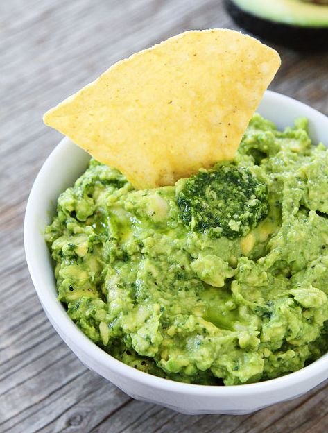 "<strong>Get the <a href=""http://www.twopeasandtheirpod.com/pesto-guacamole/"" target=""_blank"">Pesto Guacamole recipe</a> from"