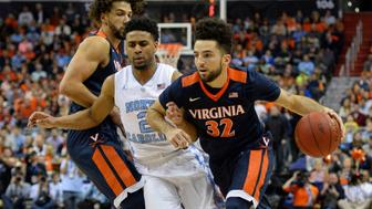 Mar 12, 2016; Washington, DC, USA; Virginia Cavaliers guard London Perrantes (32) makes a move the basket as North Carolina Tar Heels guard Joel Berry II (2) defends in the first half during the championship game of the ACC conference tournament at Verizon Center. Mandatory Credit: Tommy Gilligan-USA TODAY Sports