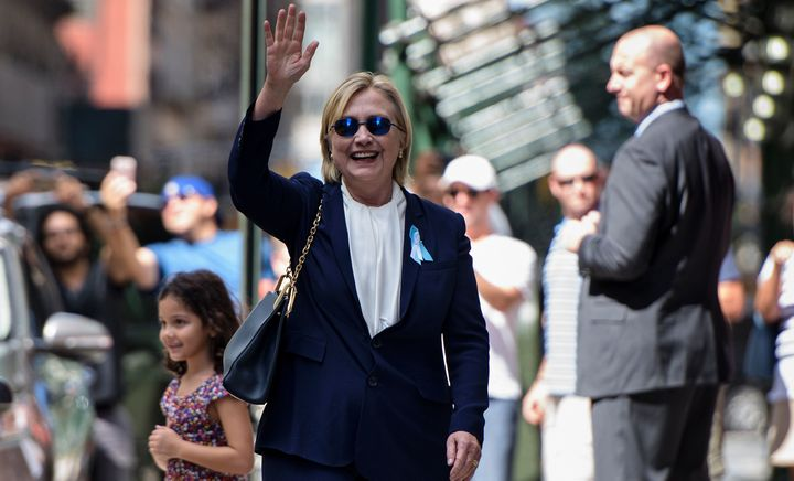 Democratic nominee Hillary Clinton leaves her daughter's apartment after resting on Sept. 11.