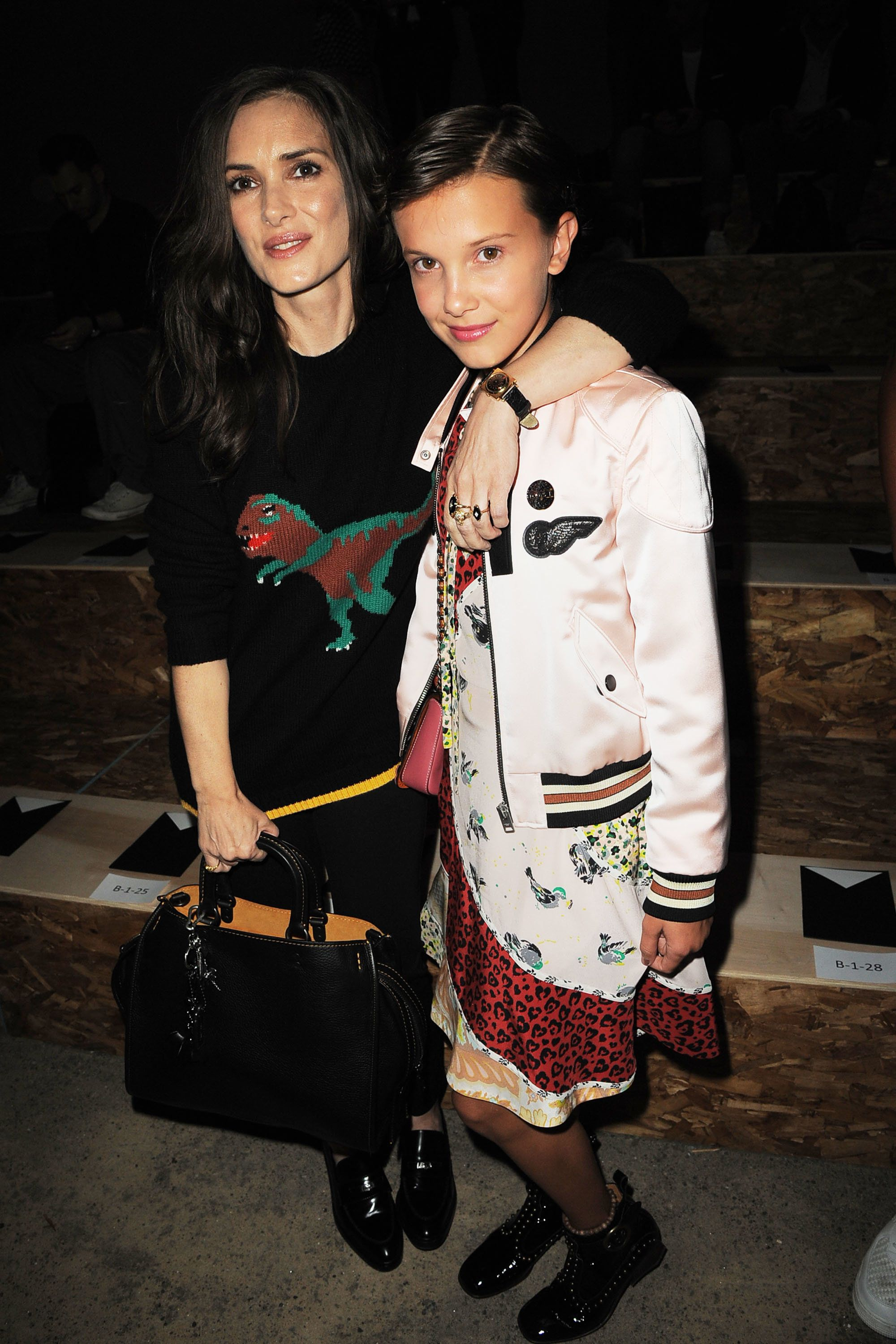 Winona Ryder and Millie Bobby Brown attend the Coach 1941 Women's Spring 2017 Show at Pier 76 on Sept. 13 in New York City.