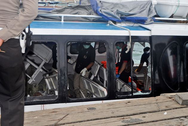 Police investigators examine the Gili Cat 2 boat following an explosion while it was enroute to nearby...