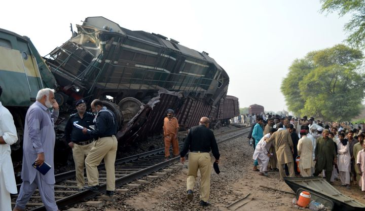 People crowd around the accident site in Multan, Pakistan.