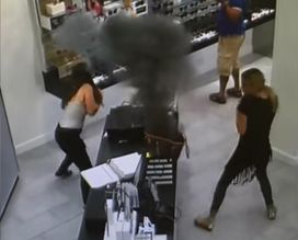 The scary moment when an e-cigarette exploded inside a woman's handbag.