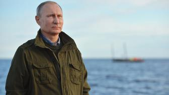 NOVGOROD REGION, RUSSIA - SEPTEMBER 10, 2016: Russia's President Vladimir Putin on a fishing boat on Lake Ilmen. Alexei Druzhinin/Russian Presidential Press and Information Office/TASS (Photo by Alexei Druzhinin\TASS via Getty Images)