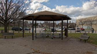 An unidentified person at Cudell Commons Park in Cleveland, Ohio, November 24, 2014 stands under a gazebo where a memorial was set up for Tamir Rice, a 12-year-old boy shot by police on November 23. Gusty winds blew the memorial made out of stuffed animals, flowers and votives over. The chief of police in the US city of Cleveland on Monday defended the conduct of the officer who fatally shot the 12-year-old who was wielding a replica handgun. Tamir Rice died in hospital early Sunday after two police officers, responding to a 911 emergency call, confronted the African-American youngster at a recreation center.  Cleveland police chief Calvin Williams said the officer, whose name or racial group he did not disclose, and who has been placed on administrative leave, was 'broken up about this.' But he stood by the officer's conduct, saying 'he had to protect himself' in the face of what appeared to be, in the heat of the moment, to be a genuine firearm. AFP PHOTO JORDAN GONZALEZ        (Photo credit should read JORDAN GONZALEZ/AFP/Getty Images)