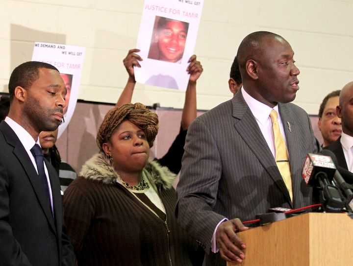 Samaria Rice, the mother of Tamir Rice, looks on as Benjamin Crump (R) speaks to the media following Rice's death.