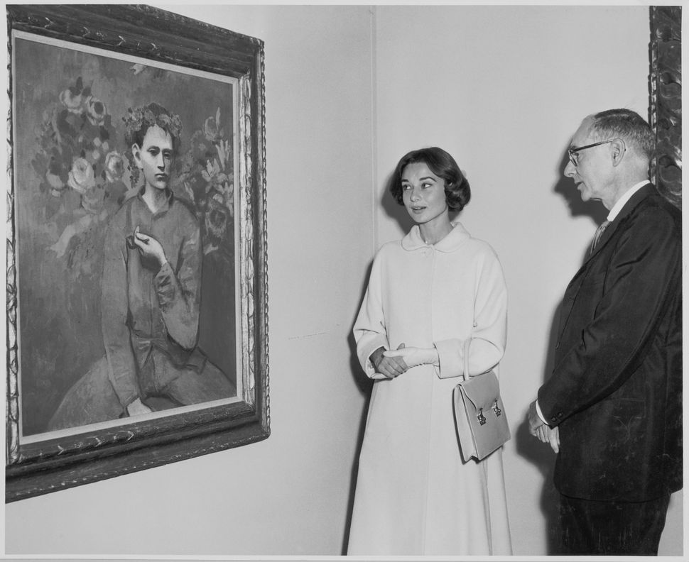 Audrey Hepburn and Alfred H. Barr, Jr. at the exhibition<i>Picasso: 75th Anniversary,</i>on view May 4, 1957 thro