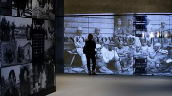 WASHINGTON, DC - SEPTEMBER 14:  Journalists tour the David M. Rubenstein History Galleries on the lower levels of the Smithsonian's National Museum of African American History and Culture during the press preview on the National Mall September 14, 2016 in Washington, DC. Filled with exhibits and artifacts telling the story of the first Africans in the United States and their descendents, the 400,000-square-foot museum will open to the public on September 24.  (Photo by Chip Somodevilla/Getty Images)