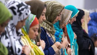 CHANTILLY, VA - SEP12: Muslims pray at the Dulles Expo Center during Eid al-Adha, the 'Feast of the Sacrifice', the second of two major holidays in Islam, September 12, 2016, in Chantilly, Vriginia.  The holiday honors the willingness of Ibrahim (Abraham) to sacrifice his son, as an act of submission to God's command. (Photo by Evelyn Hockstein/For The Washington Post via Getty Images)