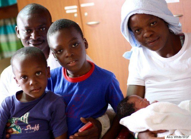 Faith Oqunbor right gave birth to Newman24 hours after MSF rescued her family from a dinghy crossing the Mediterranean