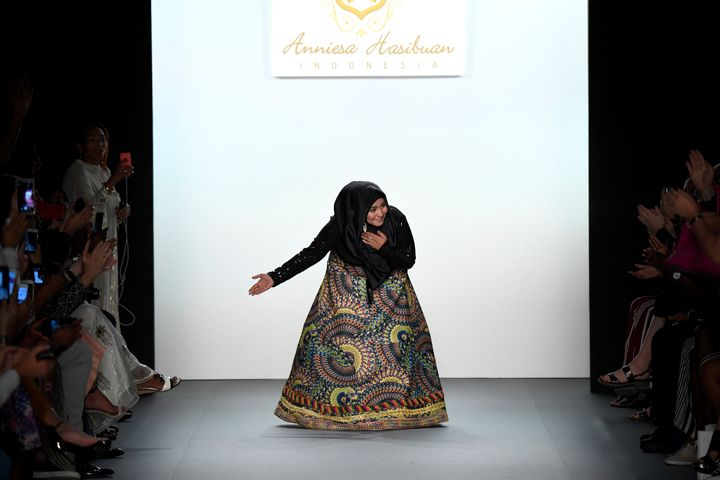 Anniesa Hasibuan takes a bow on the runway during New York Fashion Week.