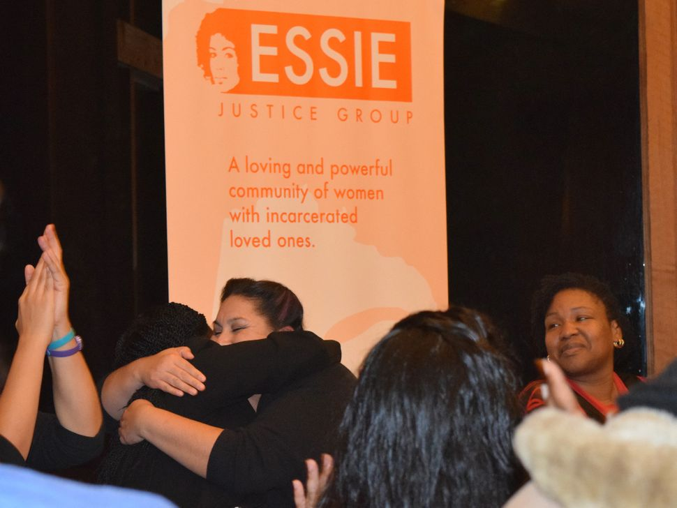 Essie members embrace at an event in January 2016.