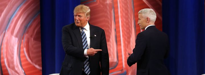 """In this file photo from February, GOP presidential candidate Donald Trump speaks with CNN's Anderson Cooper. Trump has complained that Cooper shouldn't be allowed to moderate a presidential debate because of how he """"behaves."""""""
