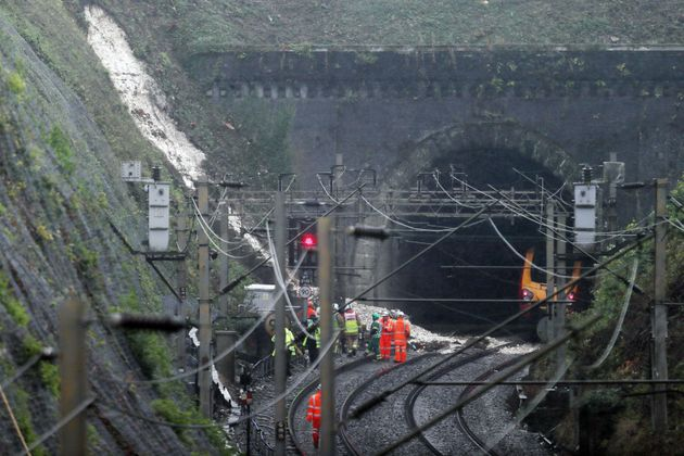 Workers at the landslip near Watford Junction station which caused a train to be derailed Friday