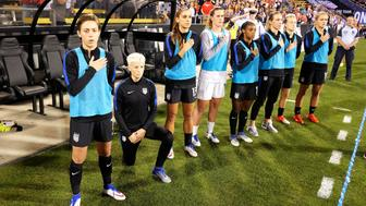 COLUMBUS, OH - SEPTEMBER 15:  Megan Rapinoe #15 of the U.S. Women's National Team kneels during the playing of the U.S. National Anthem before a match against Thailand on September 15, 2016 at MAPFRE Stadium in Columbus, Ohio.  (Photo by Jamie Sabau/Getty Images)