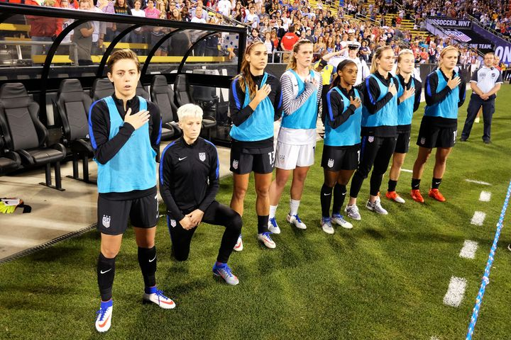 Megan Rapinoe of the U.S. Women's National Team kneels during the playing of the U.S. National Anthem before a match against