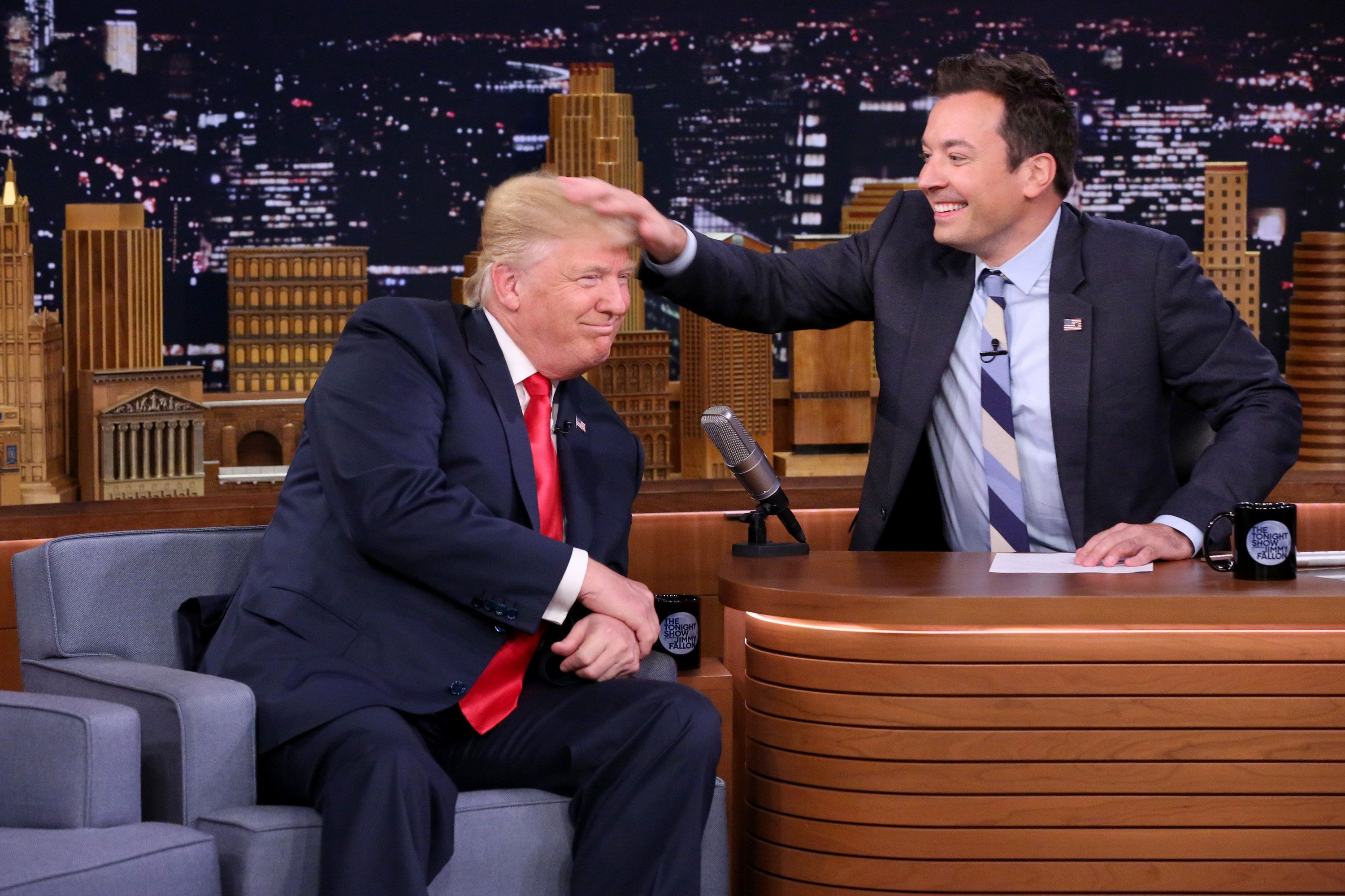 Republican Presidential Nominee Donald Trump gets a head rub during an interview with Jimmy Fallon on Sept. 15, 201