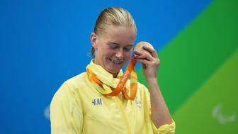 RIO DE JANEIRO, BRAZIL - SEPTEMBER 09:  Bronze medalist Maja Reichard of Sweden listens to the sound of her medal on the podium at the medal ceremony for the Women's 100m Backstroke - S11 Final on day 2 of the Rio 2016 Paralympic Games at the Olympic Aquatics Stadium on September 9, 2016 in Rio de Janeiro, Brazil.  (Photo by Friedemann Vogel/Getty Images)