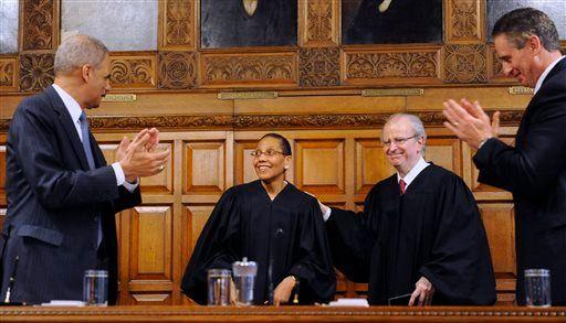 Judge Sheila Abdus-Salaam with former AG Eric Holder