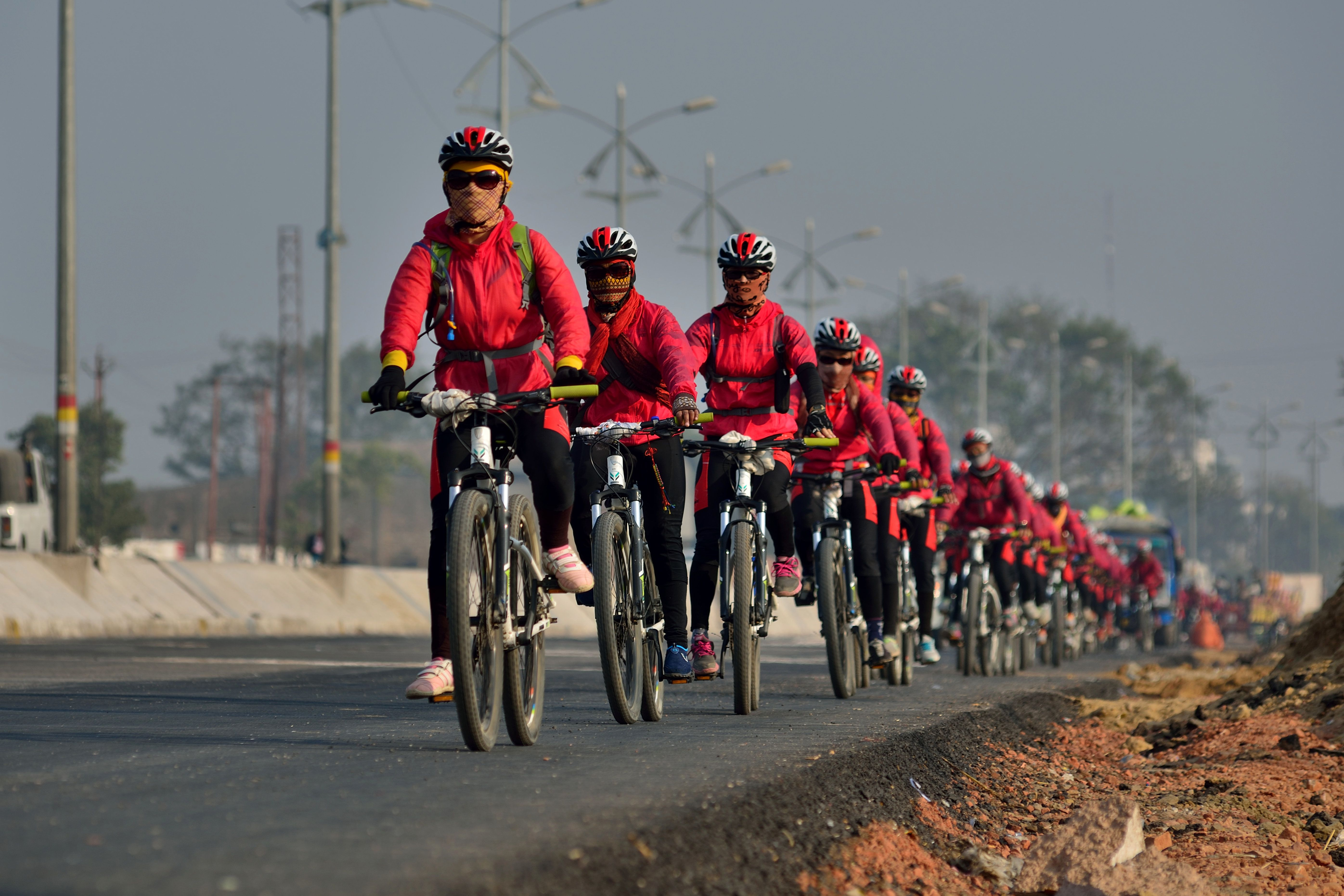 NEW DELHI, INDIA - JANUARY 4: Kung Fu nuns on cycle tour from Kathmandu to New Delhi with message of women empowerment and raise awareness on environment protection on January 4, 2016 in New Delhi, India. 250 of Buddhist nuns of the Drukpa order, known also as the Kung Fu Nuns are on a 2,200km cycle ride from Kathmandu to Delhi to spread the message of womens empowerment and environmental consciousness, emphasizing the importance of ecological balance amid economic development. (Photo by Pradeep Gaur /Mint via Getty Images)