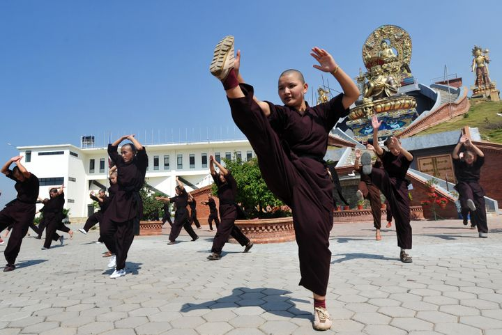 Buddhist nuns practice Kung fu at the Amitabha Drukpa Nunnery on the outskirts of Kathmandu.