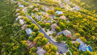 Aerial view of suburban countryside hill country near Austin Texas. Photographed from helicopter.