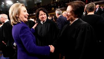 U.S. Secretary of State Hillary Rodham Clinton greets Supreme Court Justices Elena Kagan (R), and Sonia Sotomayor (C) prior to President Barack Obama's State of the Union address on Capitol Hill in Washington, January 25, 2011.   REUTERS/Pablo Martinez Monsivais/Pool  (UNITED STATES)