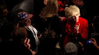 Orly Taitz (R) talks with reporters during the National Tea Party Convention at the Gaylord Opryland Hotel in Nashville, Tennessee,  February 6, 2010. REUTERS/Josh Anderson (UNITED STATES - Tags: POLITICS)