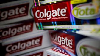 Colgate-Palmolive Co. Colgate Total brand toothpaste is arranged for a photograph in Washington, D.C., U.S. on Tuesday, Aug. 12, 2014. The chemical triclosan has been linked to cancer-cell growth and disrupted development in animals. Regulators are reviewing whether it's safe to put in soap, cutting boards and toys. At the same time, millions of Americans are putting it in their mouths every day, by way of a top-selling toothpaste that uses the antibacterial chemical to head off gum diseaseColgate-Palmolive's Total. Photographer: Andrew Harrer/Bloomberg via Getty Images