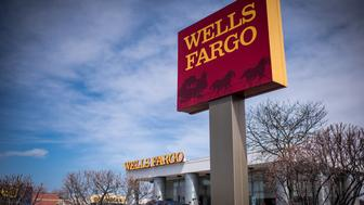 Signage is displayed outside of a Wells Fargo & Co. bank branch in Evanston, Illinois, U.S., on Monday, April 11, 2016. Wells Fargo & Co. is scheduled to release earnings figures on April 14. Photographer: Christopher Dilts/Bloomberg via Getty Images