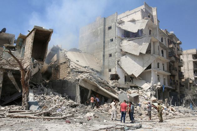Men inspect a damaged site after double airstrikes in Aleppo on Aug. 27, 2016.Some violence has...