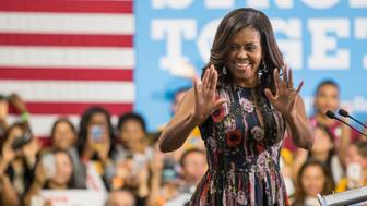 US First Lady Michelle Obama campaigns for Democratic presidential candidate Hillary Clinton at George Mason University on September 16, 2016 in Fairfax, Virginia.    / AFP / ZACH GIBSON        (Photo credit should read ZACH GIBSON/AFP/Getty Images)