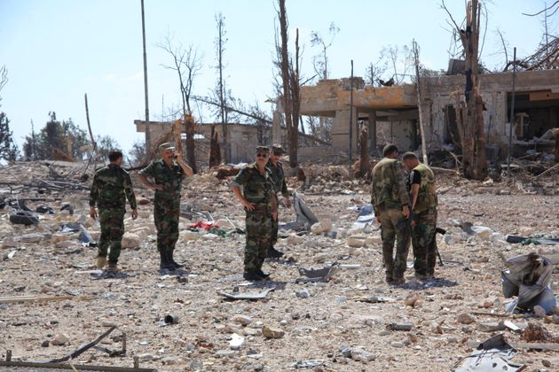 Russia has accused U.S.-led coalition jets of killing dozens of Syrian soldiers. Shownhere, forces...
