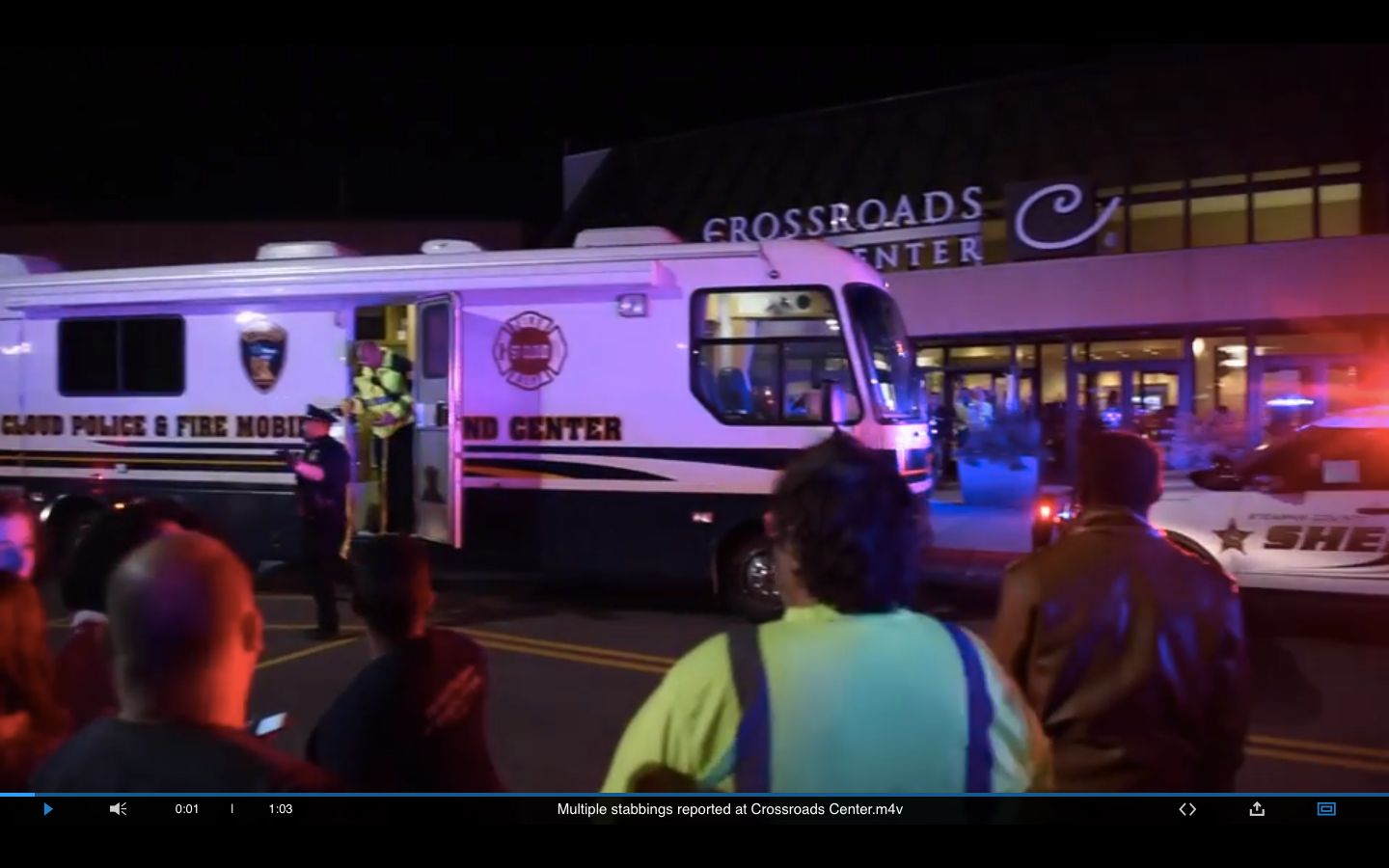 Police said a man wearing a private security uniform wounded eight people in a knife attack Saturday...