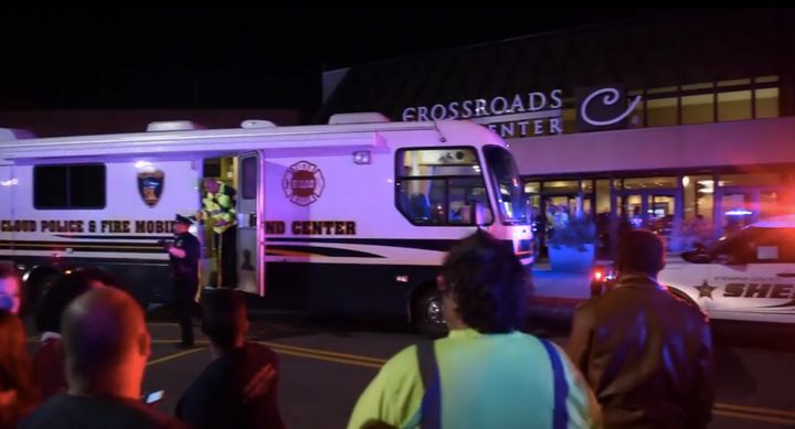 Police said a man wearing a private security uniform wounded eight people in a knife attack Saturday night at the Crossroads