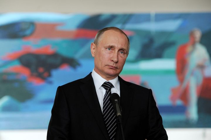 Russian President Vladimir Putin meets with reporters during a visit for a summit of former Soviet republics at Kyrgyzstan's