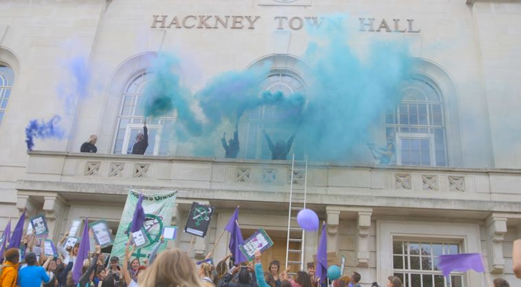 Sisters Uncut activists climb onto Hackney Town Hall balcony to demand that Mayor Glanville keeps his