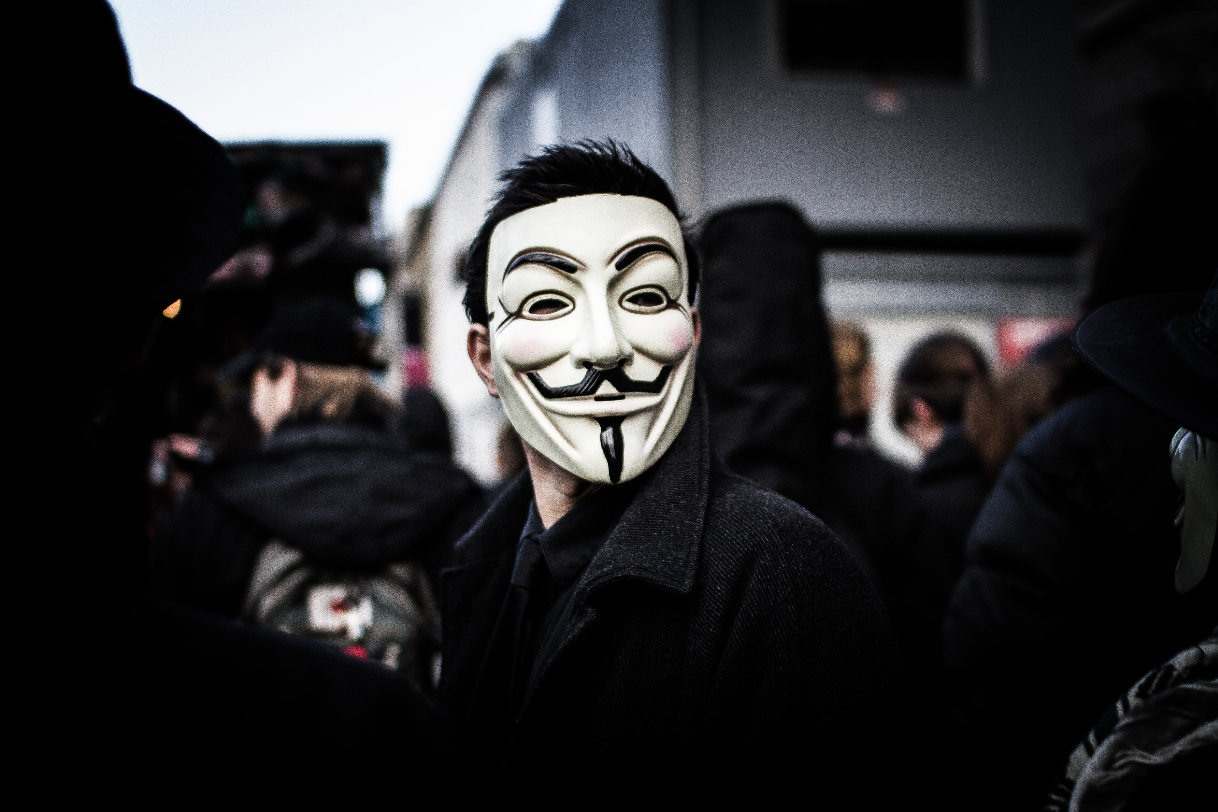 Person wears a Guy Fawkes mask which today is a trademark and symbol for the online hacktivist group Anonymous. 2012. (Photo by: PYMCA/UIG via Getty Images)