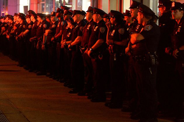 New York City Police Department officers arrive to keep watch near the site of the