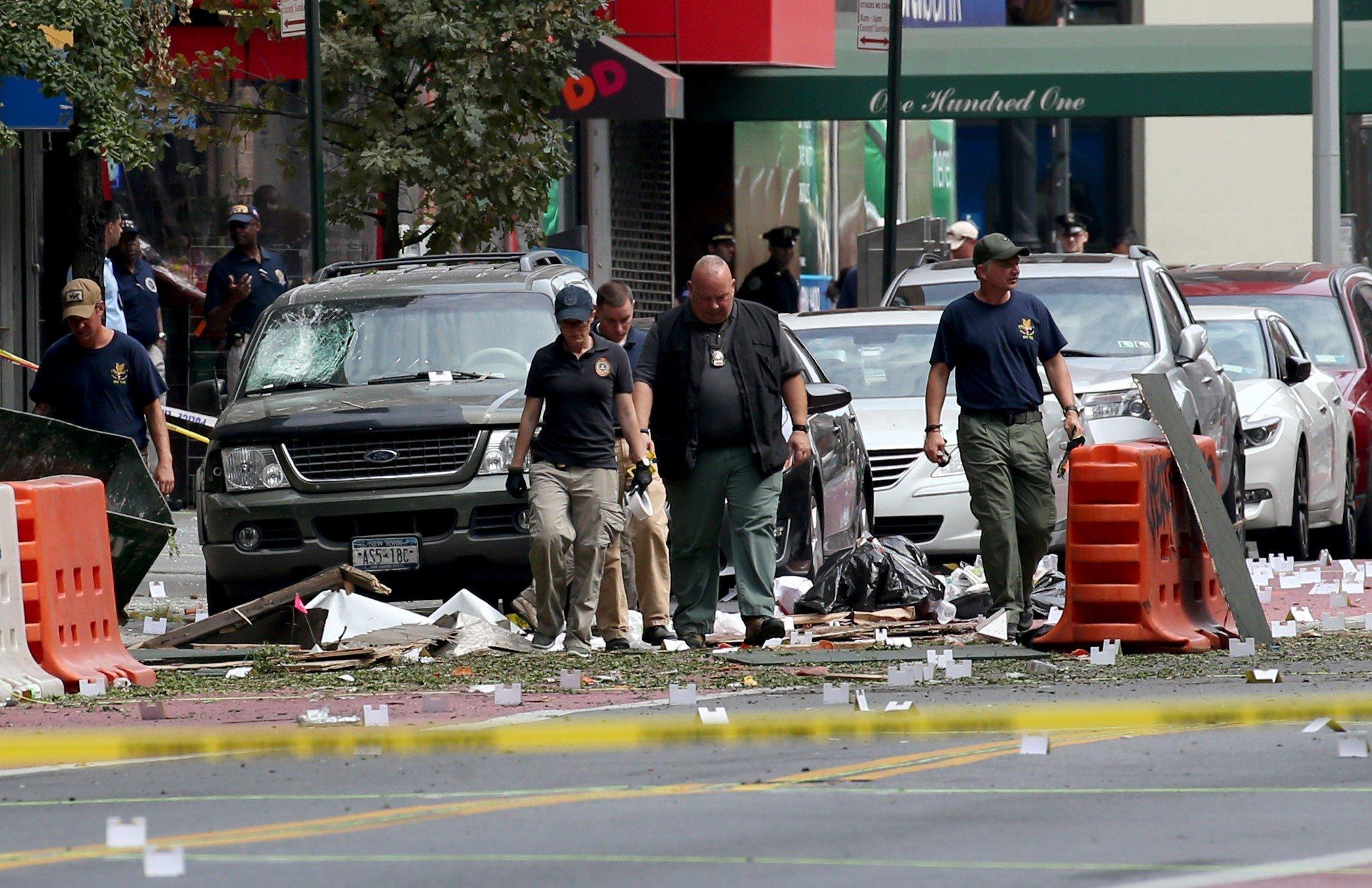 FBI investigators examine rubble at the bomb