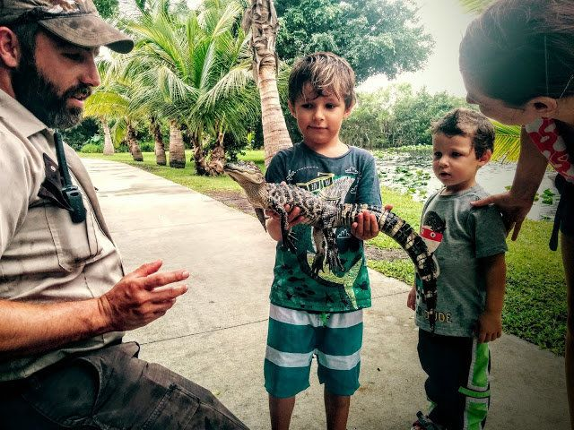 Winston and Henry King hold a baby crocodile at Everglades, Florida.
