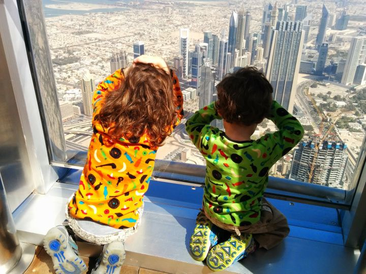 Winston and Henry King looking out of a building's windows in Dubai.