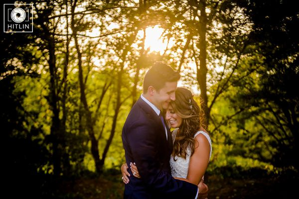 """""""The sun poked through the trees just for a moment during Deanna and Dan's wedding on Saturday in Troy, New York."""" — <i"""