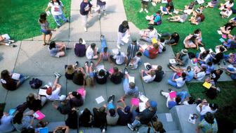 Students And Faculty Outdoors.