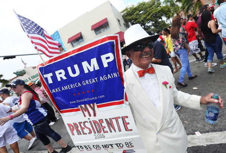 Cuban exile Santiago Portal shows off his support for Donald Trump earlier this year in Miami's Little Havana. The first gene